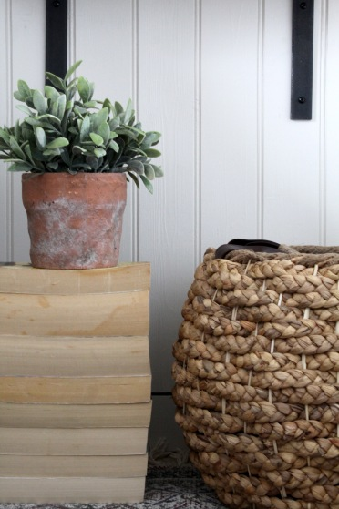 Old books, plants and baskets to add texture.