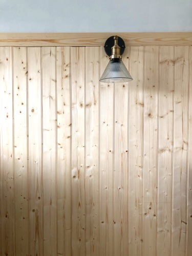 The wiring for these beautiful lights are easily hidden behind the panelling